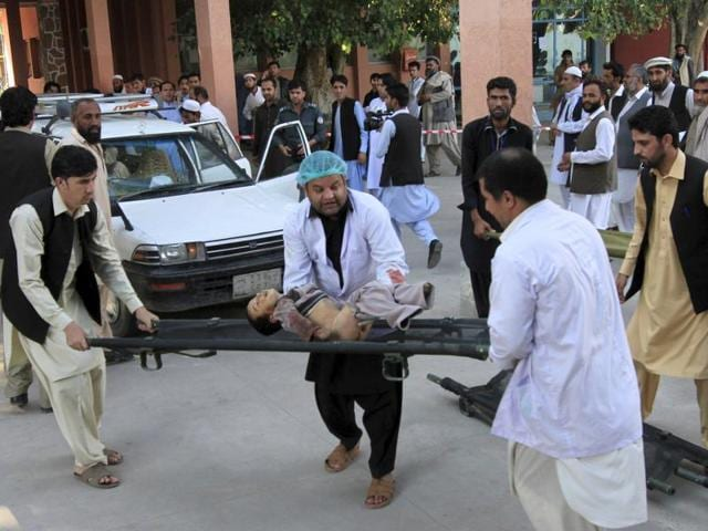 Rescue workers carry a child who was injured after an earthquake, at a hospital in Jalalabad, Afghanistan.