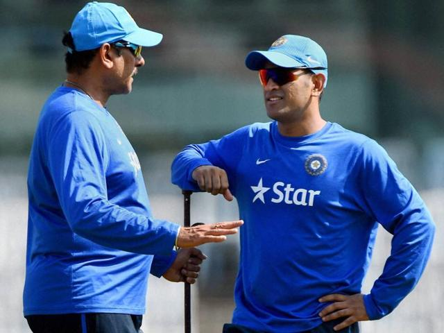 India team director Ravi Shastri, right, and captain Mahendra Singh Dhoni inspect the pitch during a practice session on the eve of the fourth ODI against South Africa in Chennai, on October 21, 2015.