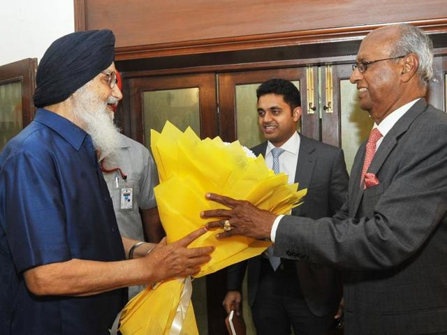 Chief minister Parkash Singh Badal greets chairman of GVK Power and Infrastructure GVK Reddy in Chandigarh on Tuesday.