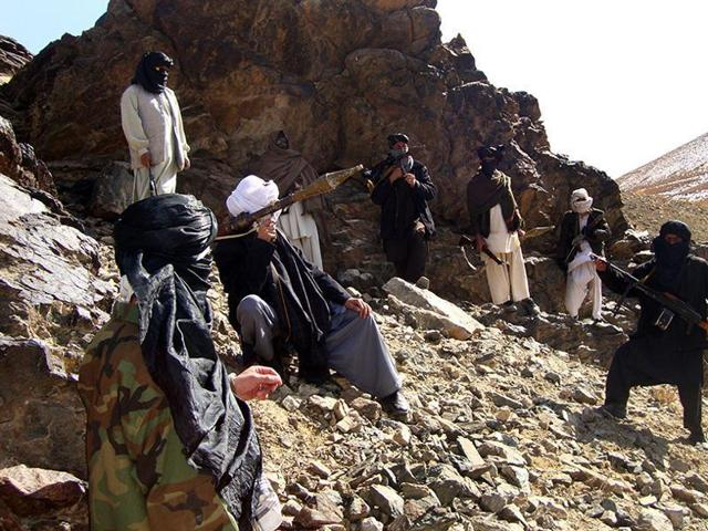 In this file photograph, Taliban fighters pose during a patrol in Ghazni province.