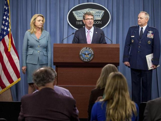 Secretary of Defense Ash Carter, center, accompanied by Air Force secretary Deborah Lee James, left, and Air Force chief of staff Gen. Mark Welsh III, right, speak at the announcement news conference that Northrop Grumman is being awarded the US Air Force's next-generation long range strike bomber contract at a news conference at the Pentagon.