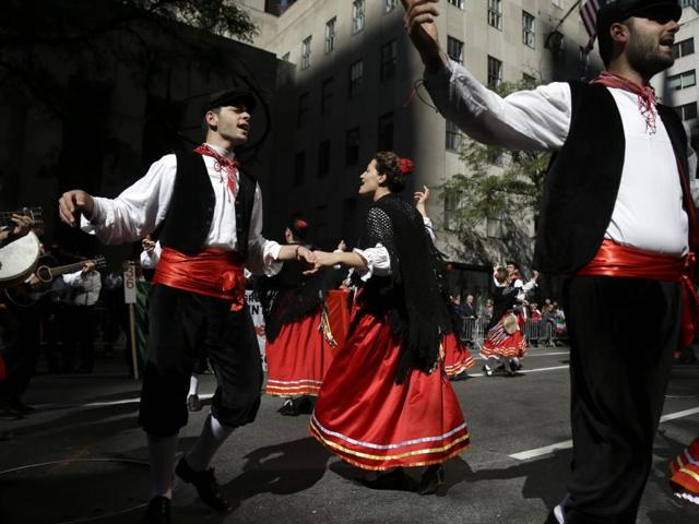 A folk dancing group performs during the Columbus Day Parade in New York. Oxford University researchers have discovered that dancing increases the body's pain threshold.