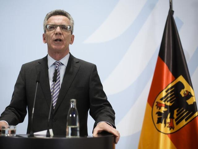 German interior minister Thomas de Maiziere briefs the media during a news conference at the Interior Ministry in Berlin. Maiziere said many of the Afghans pouring into the country will most likely be sent back to their homeland.