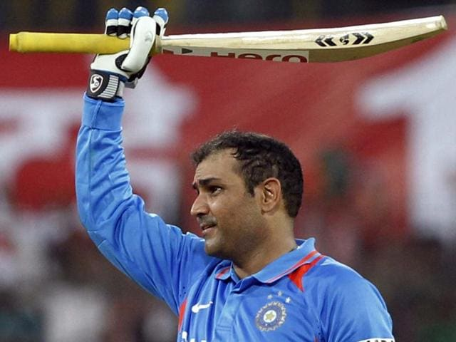 Virender Sehwag celebrates his double hundred during the 4th ODI between India and West Indies at Holkar Stadium in Indore on December 8, 2011.
