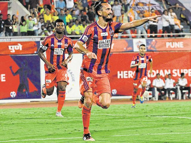 Tuncay Sanli of FC Pune City celebrates scoring the winner during the ISL match between FC Pune City and Kerala Blasters FC at the Shree Shiv Chhatrapati Sports Complex in Pune on October 27, 2015.