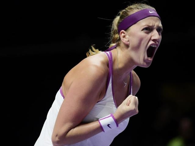 Lucie Safarova hits a backhand return to Petra Kvitova during their match at the WTA Finals in Singapore on October 28, 2015.