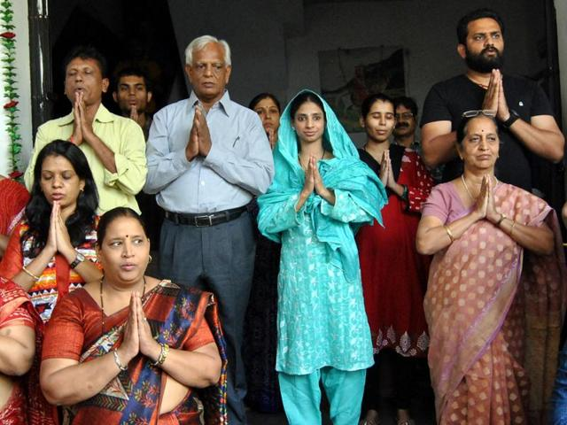 Geeta takes part in the prayers at the institute for deaf and mute in Indore on Wednesday.