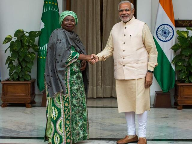 African Union Chairperson Nkosazana Dlamini-Zuma  shakes hands with Prime Minister Narendra Modi during their meeting at the India-Africa Forum Summit in New Delhi.