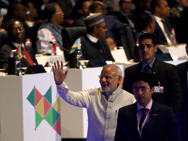 Indian Prime Minister Narendra Modi waves to delegates as he walks back after delivering his speech during the India-Africa Forum Summit in New Delhi.