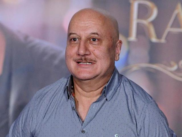 Indian Bollywood actor Anupam Kher poses for a photograph during a promotional event for Prem Ratan Dhan Payo in Mumbai on late October 1, 2015.