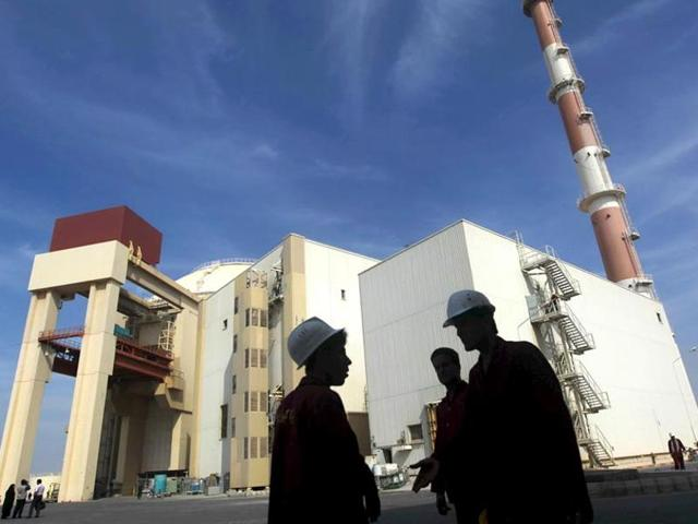 Iranian workers stand in front of the Bushehr nuclear power plant in this file photo. Former Iranian President  Akbar Hashemi Rafsanjani has said that Pakistan provided designs and technology for Iran's nuclear programme.