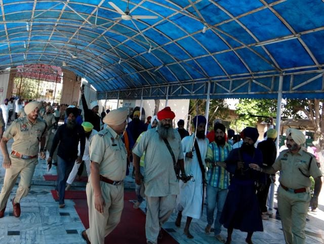 Police try  to control Sikh protestors after they rushed in the State Gurudwara in Kapurthala on October 23.