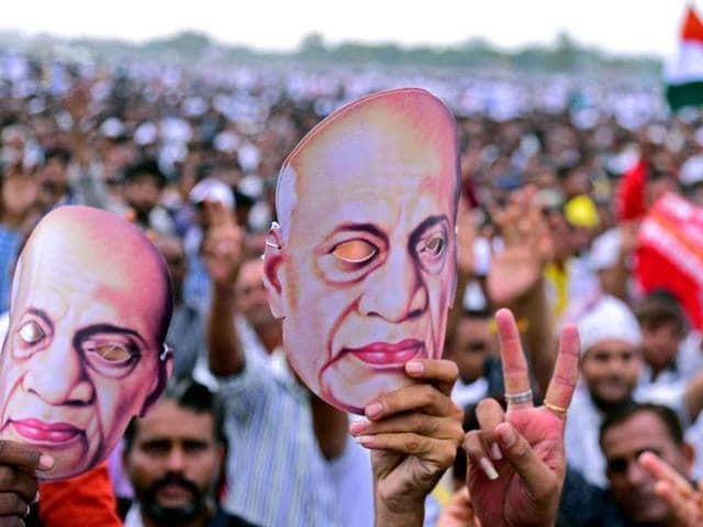 People display masks of Sardar Vallabhbhai Patel  in a rally in Ahmedabad.