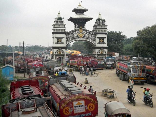 Nepalese oil tankers and commercial trucks stand stranded near a gate that marks the Nepalese border with India, in Birgunj. The fuel-starved Himalyan nation has turned to China for its gasoline needs, after India  restricted its supplies due to the political protests in Kathmandu against the new Constitution.