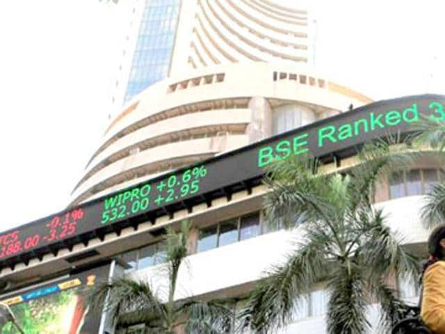 The benchmark BSE Sensex fell over 200 points, due to the October series expiry in the derivatives segment, and as US Fed hinted at a possible rate hike.