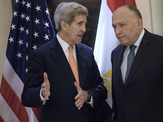US secretary of state John Kerry (L) and Egyptian foreign minister Sameh Shoukry chat before a bilateral meeting as part of talks with 17 nations, the European Union and United Nations at the Hotel Imperial, in Vienna, Austria. Kerry and other leaders are in Vienna to discuss solutions to the conflict in Syria.