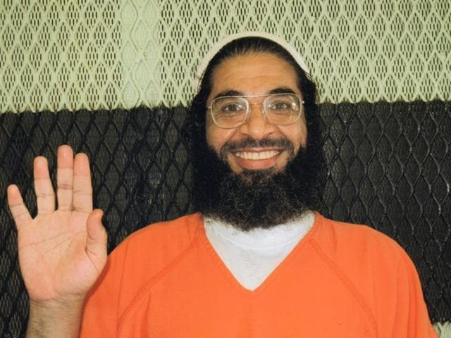 This 2013 photo provided by the International Committee of the Red Cross shows Shaker Aamer. Shaker Aamer, a Saudi who emerged as a defiant leader among prisoners during nearly 14 years of confinement on the U.S. base at Guantanamo Bay in Cuba and has now  been released to join his family in Britain.