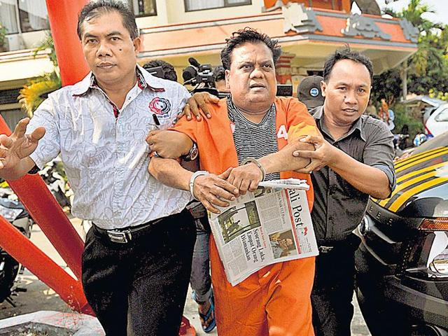 Indonesian policemen escort Chhota Rajan from the Denpasar police office on Thursday.