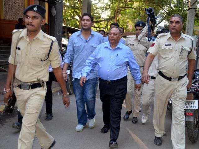 Former jail superintendent Purushottam Somkunwar being produced at district court in Indore on Thursday.