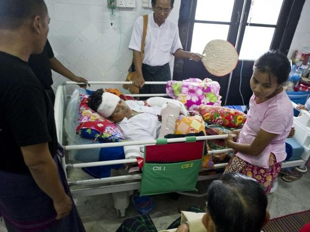 Kyaw Thu, party member of the National League for Democracy (NLD) party lies on a hospital bed at Yangon General Hospital on October 30, 2015.