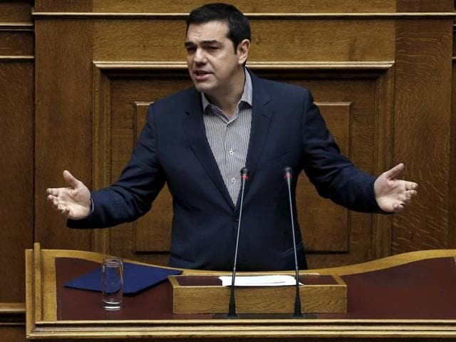 Greek Prime Minister Alexis Tsipras answers a question on migration, during the Prime Minister's Question Time at the parliament in Athens, Greece. Tsipras slammed on Friday the level of debate among European Union governments in dealing with the migrant crisis as 'sad' for a lack of cohesive action in dealing with the crisis.