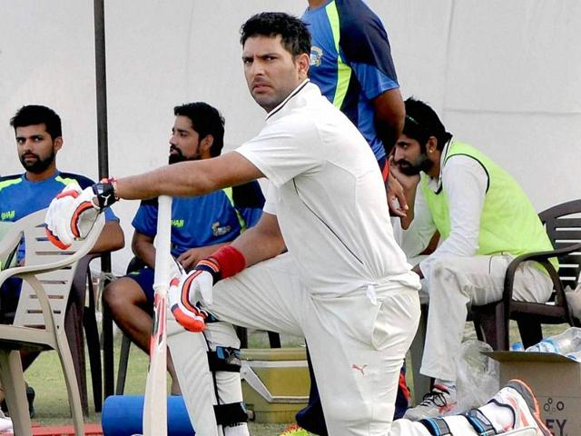 Yuvraj Singh stretches himself as he waits for his turn to bat during Ranji Trophy match against Madhya Pradesh on Friday at Patiala.