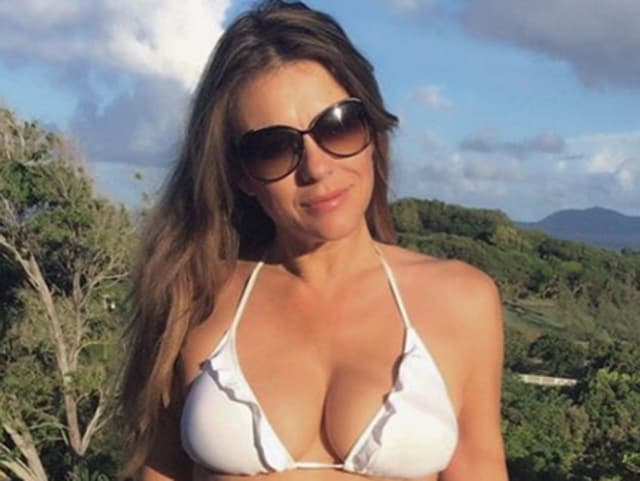 Elizabeth Hurley paid a tribute to author Jackie Collins with a poolside topless picture.