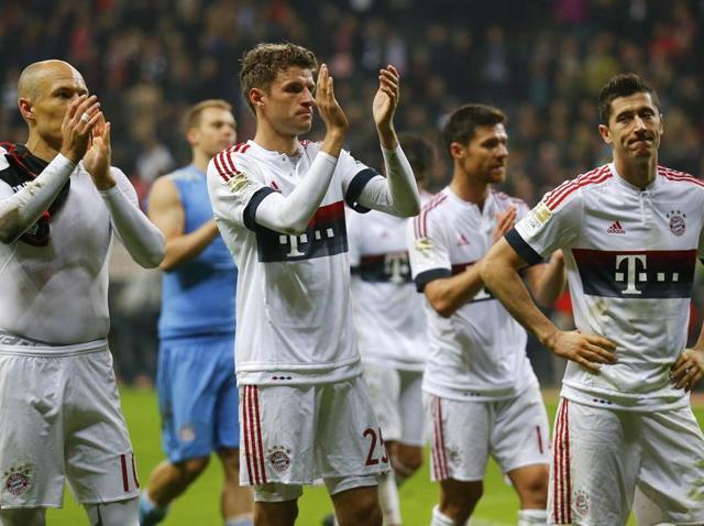 Bayern Munich players walk off the field after a goalless draw against Eintracht Frankfurt during their Bundesliga match in Frankfurt, on October 30, 2015.