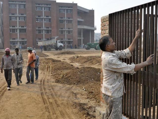 Construction work of Government  school in progress at Kishangarh, near IT park, Chandigarh on Friday, October 30, 2015.