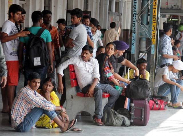Passengers sitting in a train at New Delhi Railway Station.