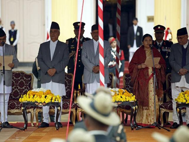 Chief Justice Kalyan Shrestha (L) administers the oath of office to Nepal's newly elected President Bidhya Bhandari (4th L) in the presence of former President Ram Baran Yadav (3rd L), former vice president Parmanand Jha (2nd L) and Prime Minister Khadga Prasad Sharma Oli, also known as KP Oli (R), at the presidential building