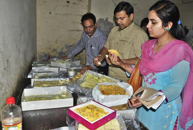 Health officials inspect  sweets at a sweet factory in Ludhiana on Saturday.