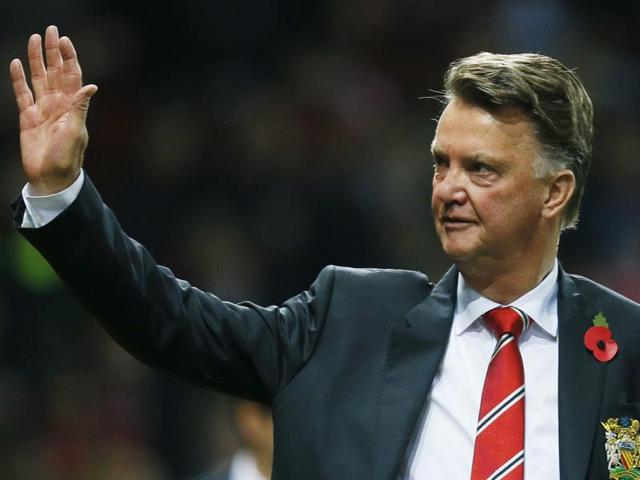 Manchester United manager Louis van Gaal waves to fans before the League Cup match against Middlesbrough on October 28, 2015.