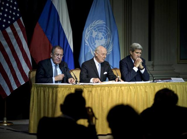 Russian foreign minister Sergei Lavrov, UN special envoy for Syria Staffan de Mistura and US secretary of state John Kerry hold a news conference at the Grand Hotel in Vienna.