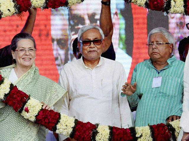 Congress president Sonia Gandhi with Bihar chief minister Nitish Kumar and RJD chief Lalu Prasad during the Swabhiman rally at Gandhi Maidan in Patna.