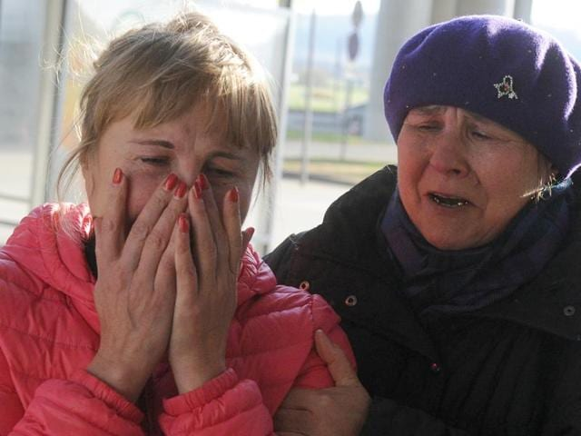 Relatives react at Pulkovo international airport outside Saint Petersburg after a Russian plane with 224 people on board crashed in a mountainous part of Egypt's Sinai Peninsula.