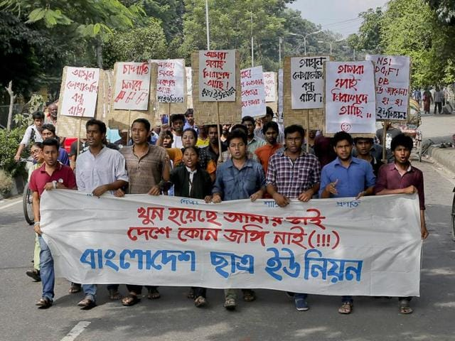 Bangladeshi students shout slogans, as they protest against the killing of Faisal Arefin Deepan, a publisher of secular books, in Dhaka, Bangladesh.