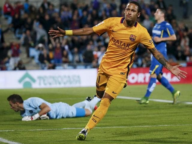 Barcelona's Luis Suarez celebrates after scoring during the La Liga match against Getafe in Getafe, Spain, on October 31, 2015.