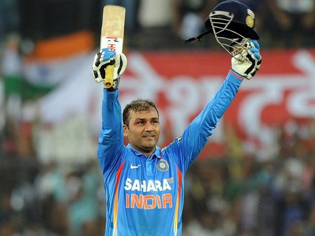A December 8, 2011 file photo of Virender Sehwag celebrating after scoring a double century during the fourth ODI between India and West Indies at The Holkar Stadium in Indore.