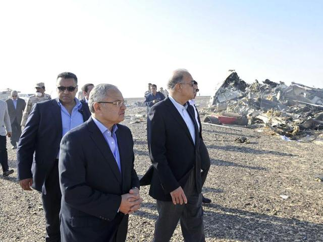 A handout picture released by Egypt's Prime Minister's office on Sunday shows PM Sherif Ismail (C-R) at the site of the wreckage of a crashed A321 Russian airliner in Hassana a mountainous area of Egypt's Sinai Peninsula.