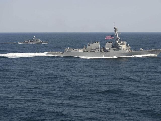 USS Lassen (DDG 82) (R) transits in formation with ROKS Sokcho (PCC 778) during exercise Foal Eagle 2015, in waters east of the Korean Peninsula, in this March 12, 2015 file handout photo provided by the US Navy.