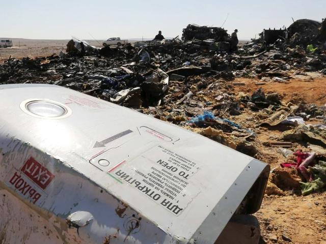 The remains of a Russian airliner are inspected by military investigators at the crashsite.