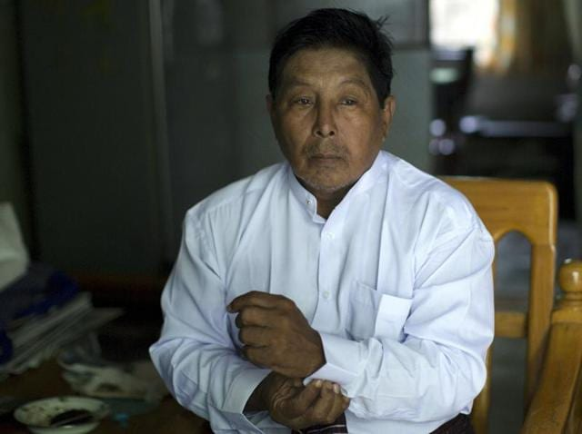 Muslim candidate Khin Maung Thein pauses during an interview with Reuters in Mandalay.
