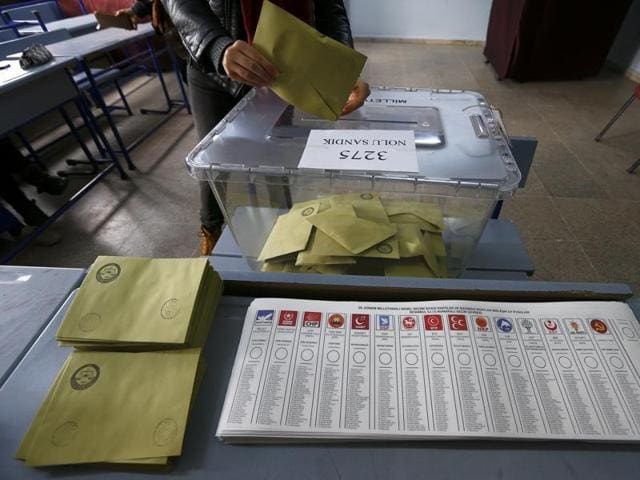 A woman leaves a voting booth at a polling station in Istanbul.