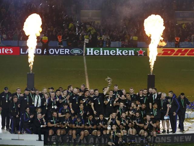 Richie McCaw of New Zealand holds the Webb Ellis Cup as he celebrates with teammates after beating Australia to win the Rugby World Cup final match at Twickenham in London, Britain.
