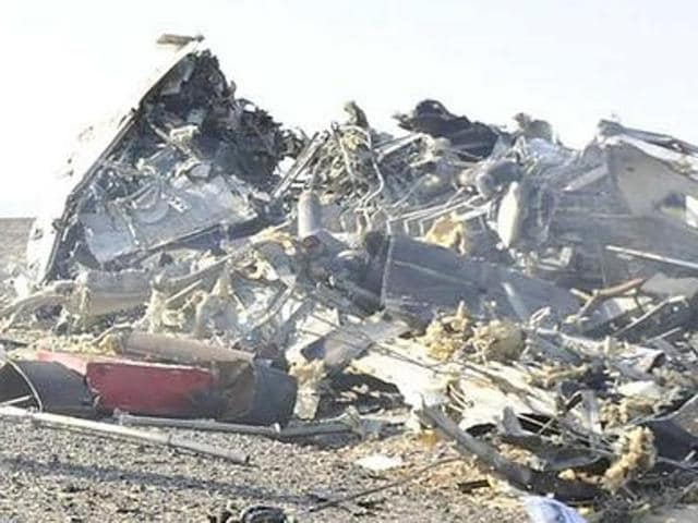 Egypt's Prime Minister Sherif Ismail looks at the remains of a Russian airliner after it crashed in central Sinai on Saturday.