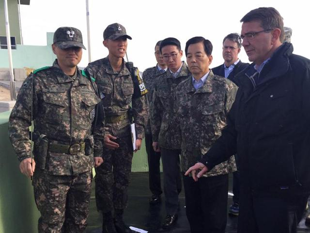 South Korean defence minister Han Min-Koo (front 2nd R) and US defense secretary Ashton Carter (R) interact as they visit Observation Post Ouellette, the closest post to the demarcation line between the two Koreas, in Paju on November 1, 2015.