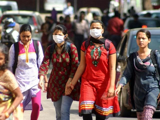 Girls wearing masks at Hamidia Hospital in Bhopal for protection from swine flu.
