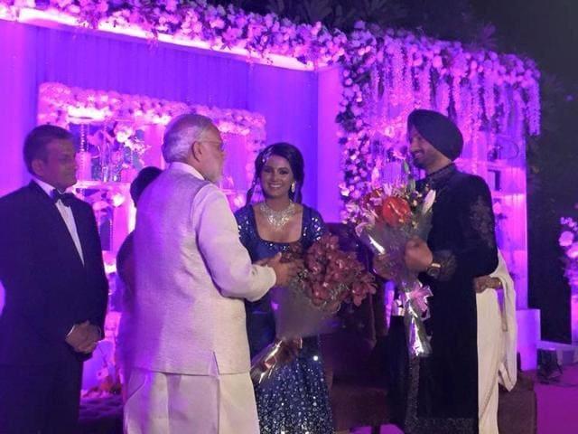 PMNarendra Modi with Harbhajan Singh and Geeta Basra at the reception.