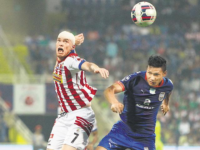 Iain Hume (left) was yet to score this season but got off the mark with a fine hattrick against Mumbai on Sunday.